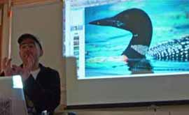 Photo of Rob Alvo with loon picture