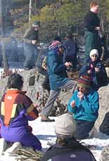 Group having lunch on a frozen pond