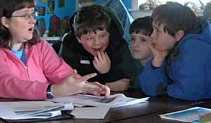 Photo of Pat Whitridge talking to group