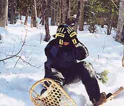 Photo of snowshoer in despair