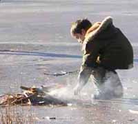 Photo of Macoun member making lunch fire on ice