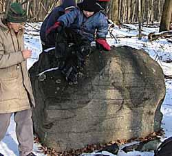 Macouners at glacial erratic