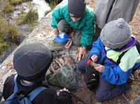 Photo of kids starting a lunch fire