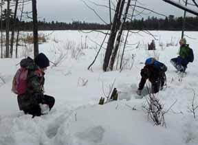 photo of kids struggling through deep snow