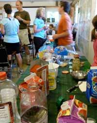 Photo of people milling about food table