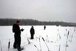 Photo of Macoun members crossing Pond V