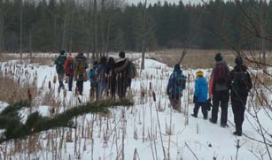 Photo of Macoun Club members approaching beaver lodge