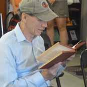 Photo of Rob Lee reading aloud from book