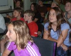 Photo of Macoun Club members watching movie