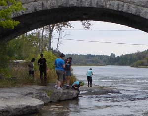 Photo of group under arch of stone bridge