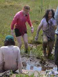 Photo of kids sinking into the bog