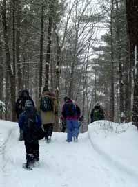Photo of Macoun members walking over the hills