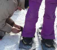 Photo of modern snowshoer being fitted