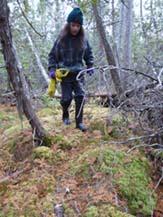 Photo of Macoun member walking over deep moss