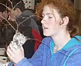 Photo of girl examining bird nest