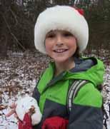 Photo of girl wearing Santa hat