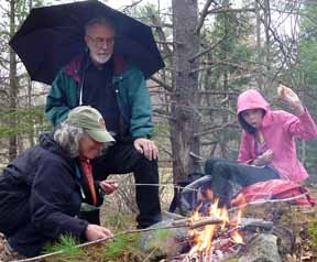 Photo of group by lunch fire in the rain