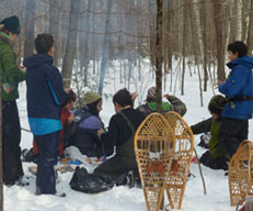 Photo of group around the lunch fire