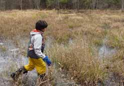 photo of Macouner striding through cold pond
