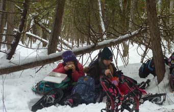 Photo of kids eating lunch in the snow