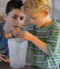 Photo of boys examining live worms