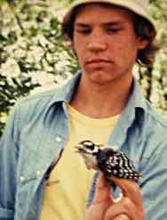 Photo of Macoun Club member Bob Bracken holding Downy Woodpecker, 1977