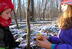 Macoun members Johnny Pimm and Madeleine Poirier in winter forest