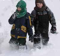 Photo of Julien and Patrick Caron snowshoeing