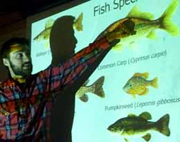 Photo of Nic Lapointe pointing at features of a Carp