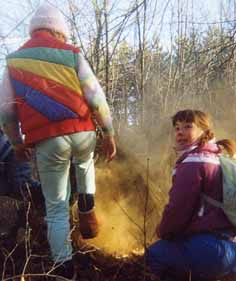Photo of Macoun Club member Rebecca Danard and Solange Courteau puffing puffballs