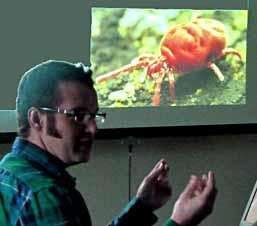 photo of speaker Wayne Knee with picture of Velvet Mite