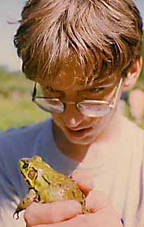 Photo of William Godsoe with a Bull Frog