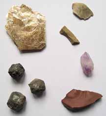 Photo of phlogopite mica, chert chips, amethyst, jasper, and garnet crystals