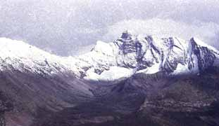 Photo of mountain tops with fresh snow
